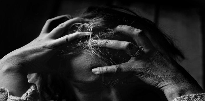 Head in hands in pain