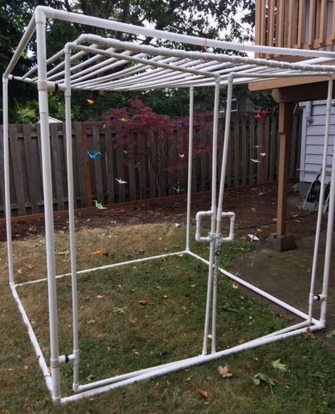 Picture of the cage being used for the Uncaging One Thousand Cranes project